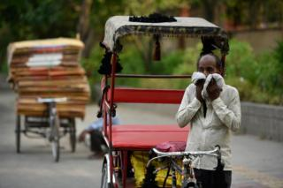A rickshaw puller wipes his face with a cloth on a hot summer day, as temperatures in the capital reach 45 degree Celsius, on May 31, 2019 in New Delhi, India.