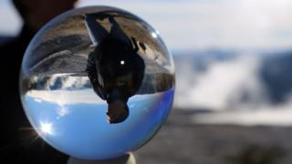 Man seen through a crystal ball
