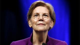 Senator Elizabeth Warren at a podium