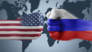 US v Russia flags on fists