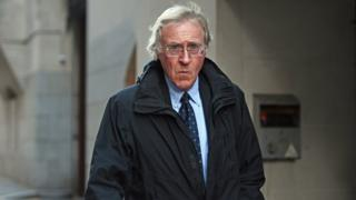 Dr Tutin leaves the Old Bailey in London