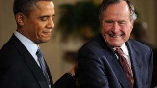 US President Barack Obama presents the 2010 Medal of Freedom to former President George HW Bush in this February 15, 2011