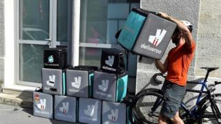 Deliveroo delivery bags and driver
