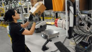 Worker in an Amazon fulfilment centre