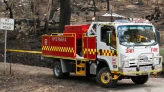 A fire truck passes burned-out properties in the community of Wye River on Boxing Day