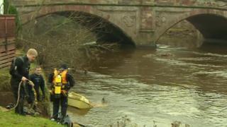 Divers examine Appleby bridge
