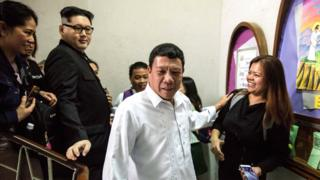 A Philippine President Rodrigo Duterte impersonator (C), who goes by the name Cresencio Extreme, and a North Korean leader Kim Jong-un impersonator, who goes by the name Howard X
