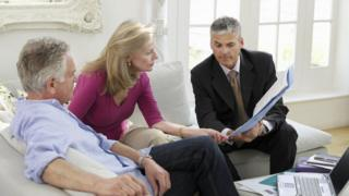 financial adviser with older couple