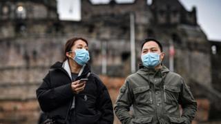 women wearing face masks at Edinburgh castle