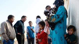David Cameron meets with refugees at a camp in Lebanon last week.