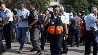 Israeli emergency services personnel at the scene of a stabbing attack in Jerusalem's Ammunition Hill district (12 October 2015)