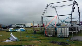 The festival site has been hit by heavy winds and rain