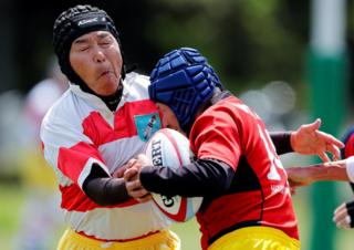 Members of Tokyo's Fuwaku Rugby Club train outdoors