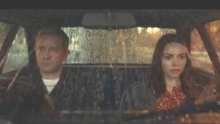Martin Freeman and a woman sitting in a car during the advert