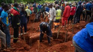 People dig multiple graves for their relatives