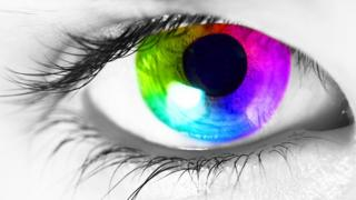 A close up of a human eye with a multi-coloured iris