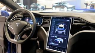 Technology The interior on a Tesla Model S full electric luxury car with a large touch screen and dashboard screen.
