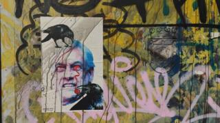 A mural showing Sebastián Piñera with his eyes painted red in reference to the protesters blinded by police projectiles