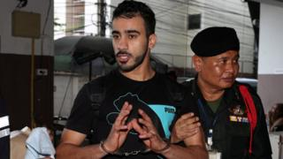 Hakeem Al-Araibi is held by Thai security officials as he arrives in court in Bangkok in December