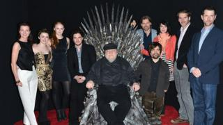 George R.R. Martin (centre) posing with some of Game of Thrones' protagonists