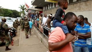 People queue at a supermarket in Harare on Wednesday