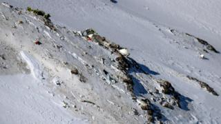 The wreckage of a plane that crashed near a mountain peak two days earlier in Iran's Zagros mountain range.