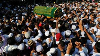Supporters carry the coffin of Ko Ni, after he was shot dead, in Yangon, Myanmar, on 30 2017