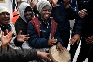 Migrants play music aboard MV Aquarius