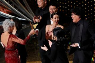 Kwak Sin Ae and Bong Joon Ho win the Oscar for Best Picture