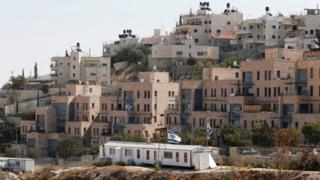 Buildings forming part of Nof Zion, a Jewish settlement in occupied East Jerusalem, are seen in the foreground as buildings from the Palestinian district of Jabal Mukaber are seen in the background (25 October 2017)