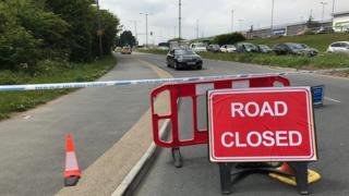 Closed road at crash scene.