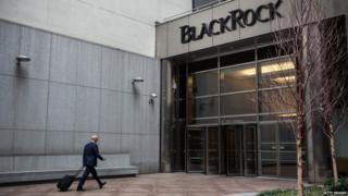 A man walks into BlackRock's New York office