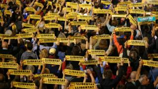 "People hold banners reading ""Freedom Political Prisoners"" during a gathering in support of the members of the dismissed Catalan cabinet after a Spanish judge ordered the former Catalan leaders to be remanded in custody pending an investigation into Catalonia""s independence push, outside Barcelona""s town hall, Spain, November 3, 2017"