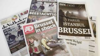 Front pages of several Dutch newspapers,in the Hague, The Netherlands, 23 March 2016 one day after at least 31 people were killed in and hundreds injured in bombings at Zaventem Airport and on a metro train in Brussels, Belgium, 22 March 2016.
