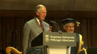 Prince Charles at a podium opening the campus