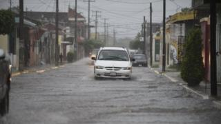 View of a flooded street as the storm Willa arrives to Escuinapa, Sinaloa state, Mexico, on October 23, 2018. -