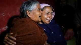 An elderly woman cries as she hugs Bonomala Santra (R), mother of Bablu Santra, a Central Reserve Police Force (CRPF) trooper killed on Thursday, at Bauria village in Howrah district, West Bengal