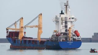 The BBC Shanghai cargo ship leaves harbour in Cherbourg. 15 Oct 2015