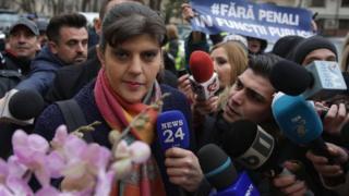 Reporters surround Ms Kovesi