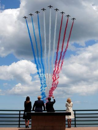 President Trump First Lady Melania Trump, French President Emmanuel Macron and his wife Brigitte Macron watch a flypast in the Normandy American Cemetery