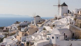Traditional Windmill at Oia village on July 16 2018 in Santorini, Greece