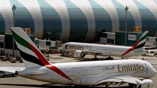 In this May 8, 2014 file photo, Emirates passenger planes are in use at Dubai airport in United Arab Emirates.