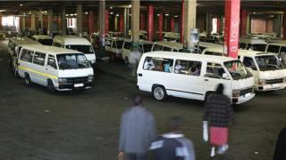 South Africans walk to taxis at the Bree taxi rank on June 4, 2009 in Johannesburg