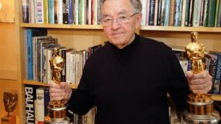 Norman Reynolds with his two Oscars