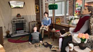 Knitted family in 1950s sitting room