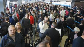 "Passengers at O""Hare International Airport wait in line to be screened at a Transportation Security Administration (TSA) checkpoint on May 16, 2016 in Chicago, Illinois"