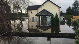 The couple's home was submerged in 5ft of water at one stage