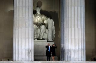 US President-elect Donald Trump and his wife Melania wave at the Make America Great Again! Welcome Celebration at the Lincoln Memorial in Washington