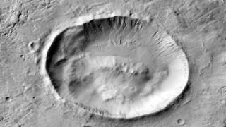 A satellite image, taken by Nasa's CTX camera, shows the Mars crater now named as Langtang