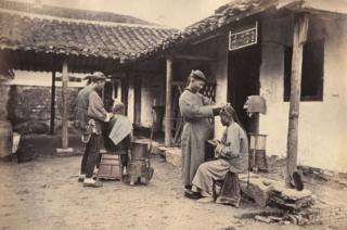 William Saunders, Itinerant Barbers, 1860s-1870s. Hand-tinted albumen silver print. No. 24 in Sketches of Chinese Life and Character series